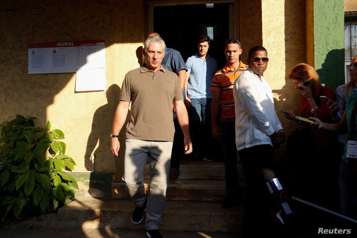 Cuba's First Vice President Miguel Diaz-Canel (L) leaves a polling station after casting his vote in Havana, Cuba, Nov. 26, 2017. Diaz-Canel is widely expected to replace 86-year-old Cuban President Raul Castro following elections next year.