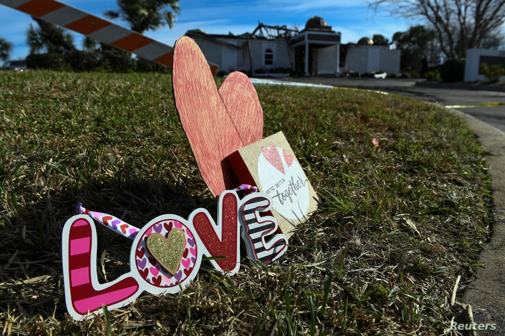 Signs rest outside the Victoria Islamic Center a day after a fire destroyed the mosque in Victoria, Texas, Jan. 29, 2017.