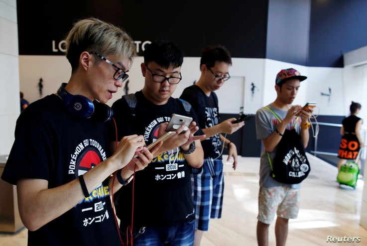 Participants take part in the world's first Pokemon Go competition in Hong Kong, China, Aug. 6, 2016.