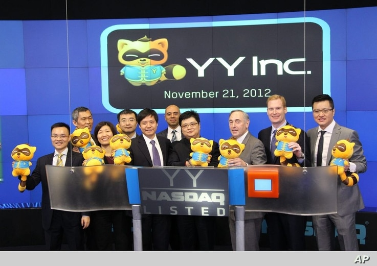 FILE - One of the biggest Chinese hosting sites, YY Inc. rings The NASDAQ Stock Market Opening Bell in Celebration of IPO.