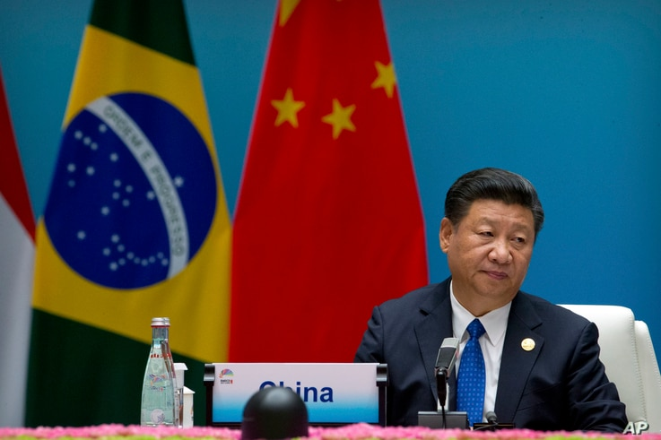 Chinese President Xi Jinping listens to a speech during the Dialogue of Emerging Market and Developing Countries in Xiamen in southeastern China's Fujian Province, Tuesday, Sept. 5, 2017.