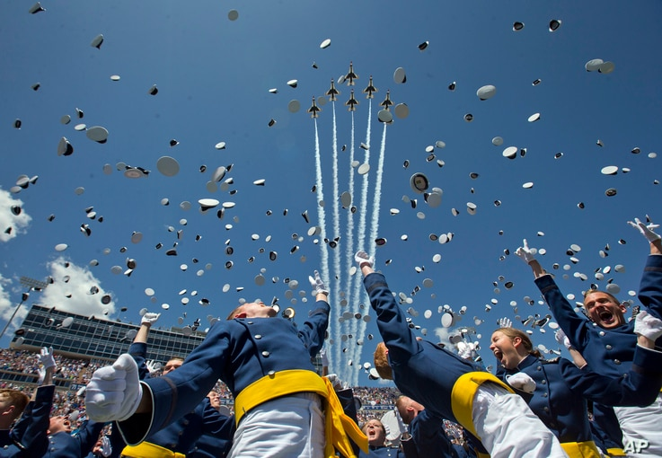 "The Air Force Thunderbirds fly overhead as graduating cadets celebrate with the ""hat toss"" after graduation ceremonies at the 2016 class of the U.S. Air Force Academ, in Colorado Springs, Colorado, June 2, 2016."