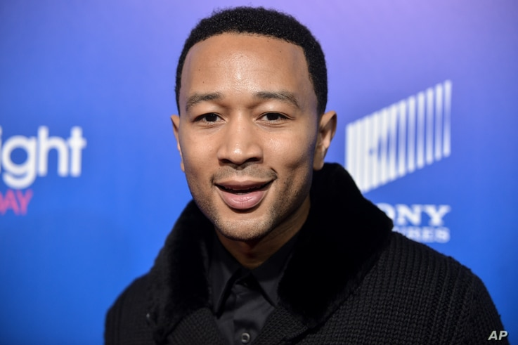 FILE - John Legend arrives at Pan African Film and Arts Festival premiere.