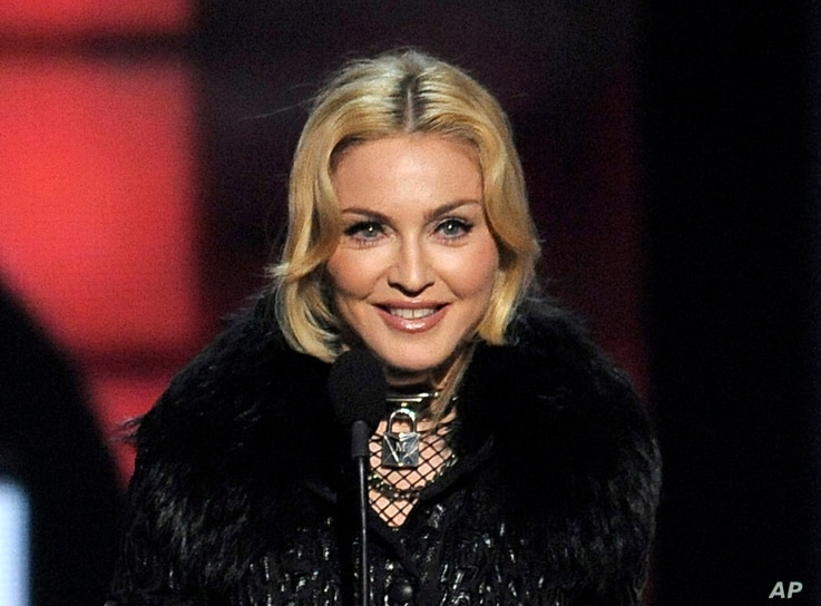 FILE -  Madonna accepts the award for top touring artist at the Billboard Music Awards in Las Vegas.