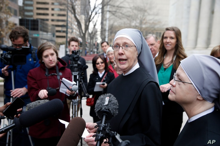 FILE - Sister Loraine, of Little Sisters of the Poor, speaks to members of the media after attending a hearing in the 10th U.S. Circuit Court of Appeals, in Denver, Colorado, Dec. 8, 2014.