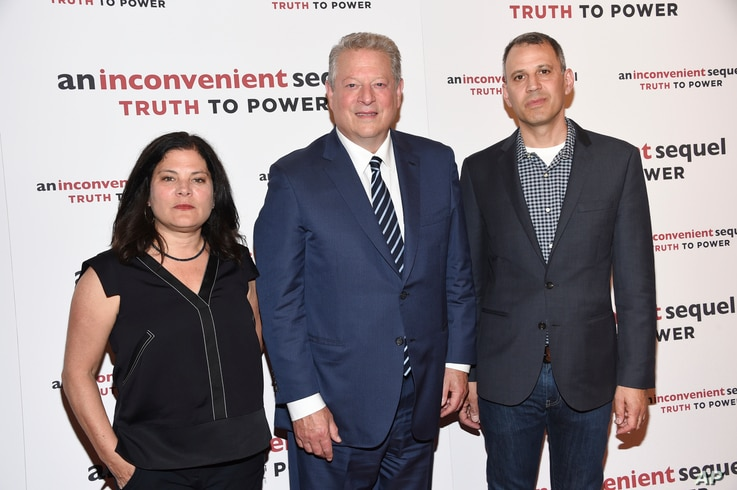 """Co-directors Bonni Cohen, left, and Jon Shenk, right, pose with former U.S. Vice President Al Gore at a special screening of """"An Inconvenient Sequel: Truth To Power"""" at The Whitby Hotel in New York, July 17, 2017."""