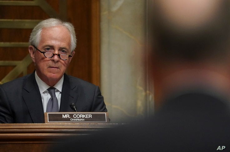 Chairman Sen. Bob Corker, R-Tenn., left, listens to General C. Robert Kehler, right, USAF (Ret.) former Commander United States Strategic Command, during a Senate Foreign Relations Committee hearing on North Korea on Capitol Hill in Washington, Nov. ...