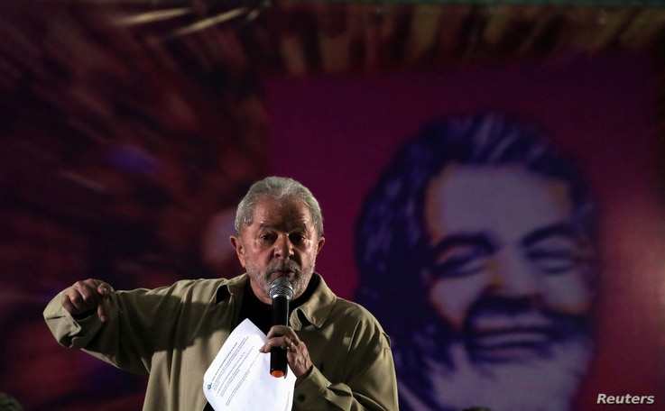 Former Brazilian President Luiz Inacio Lula da Silva gestures as he attends a meeting with women activists in Santo Andre, Brazil, Aug. 15, 2016.