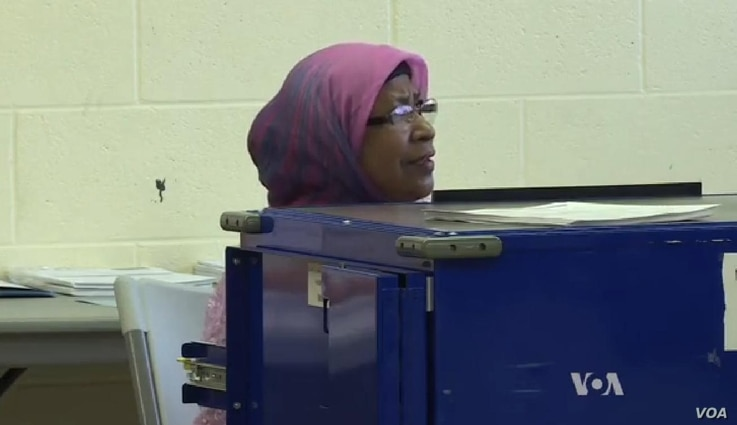 Bangladeshi immigrant Rashida Parveen voted in her first U.S. election in 2000 and now assists as a translator at a Chicago polling site.