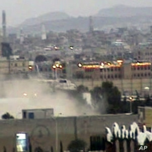 In this image taken from TV, showing Yemeni army helicopter emerging from the dust as it airlifts U.S. and other ambassadors out of a besieged embassy in Sanaa, Yemen, to the Presidential Palace to witness ruling party leaders signing an agreement fo...