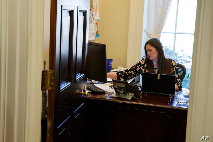 White House deputy press secretary Sarah Huckabee Sanders works in her office at the White House in Washington, March 8, 2017.