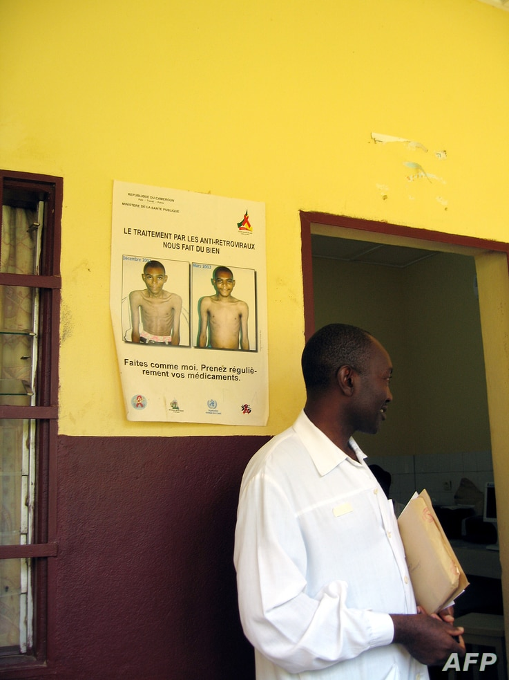 FILE - A wall displays a sign on how treatment with antiretroviral drugs can make you healthier at the Mfou district hospital, 30 kms from Yaounde, in Cameroon, Sept. 27, 2007.
