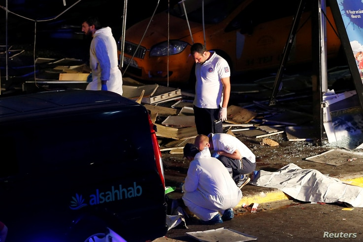 Forensic experts work outside Turkey's largest airport, Istanbul Ataturk, following a blast in Turkey, June 28, 2016.