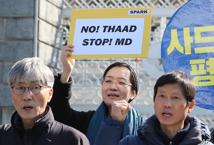 Protesters shout slogans during a rally to oppose the plan to deploy the Terminal High-Altitude Area Defense system, or THAAD, in front of the Defense Ministry in Seoul, March 7, 2017.