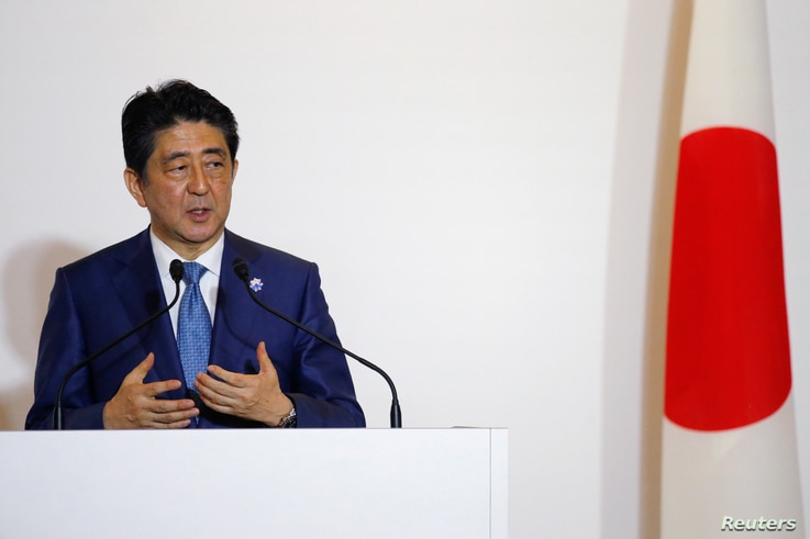 Japan's Prime Minister Shinzo Abe answers a question during a press conference with U.S. President Barack Obama after a bilateral meeting during the 2016 Ise-Shima G7 Summit in Shima, Japan May 25, 2016.