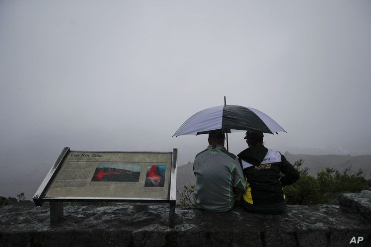 A couple sits on the edge of the Jaggar Museum's overlook to view Kilauea's summit crater in Volcanoes National Park, Hawaii, May 10, 2018.