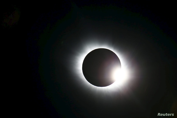 A total solar eclipse occurs over Svalbard in the Arctic Ocean, March 20, 2015.
