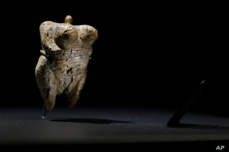 In this June 27, 2017 photo the 'Venus of Hohle Fels' figure is pictured in the Prehistory Museum in Blaubeuren, Germany. The 40,000 years old ivory Venus figurine is considered the oldest example of human figurative prehistoric art.