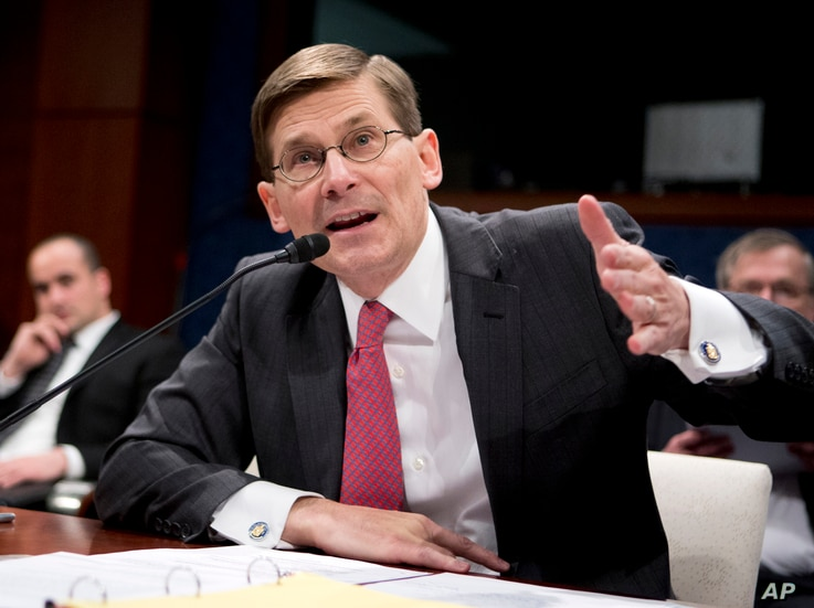 Former CIA Deputy Director Michael Morell testifies on Capitol Hill in Washington, April 2, 2014, before the House Intelligence Committee.