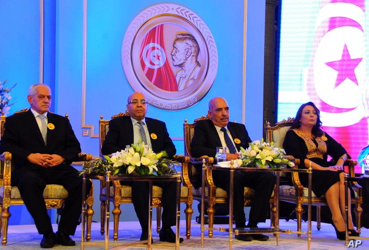 FILE - Left to right, Tunisian Nobel Peace Prize Winners Houcine Abassi, Abdessattar Ben Moussa, Fadhel Mafoudh and Wided Bouchamaoui are seen at a ceremony in Tunis, Nov.9, 2015.