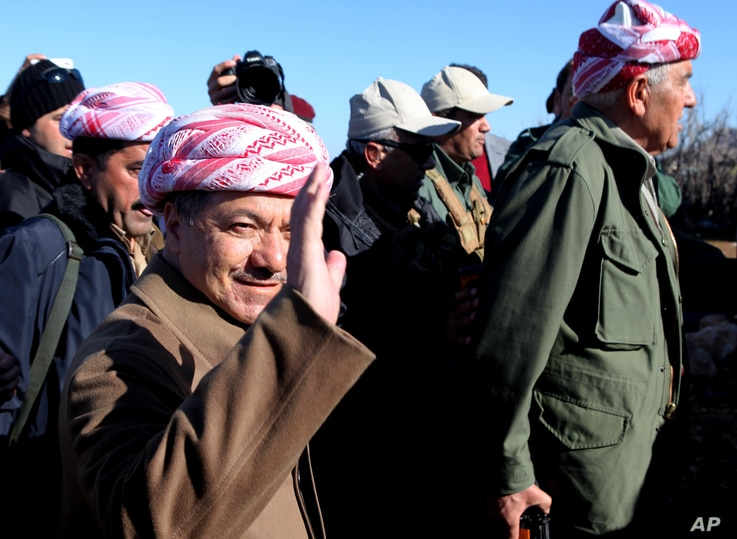 Kurdistan Iraqi regional government President Massoud Barzani arrives to support Kurdish forces as they head to battle Islamic State militants, on the summit of Mount Sinjar, in the town of Sinjar, Iraq, Dec. 21, 2014.
