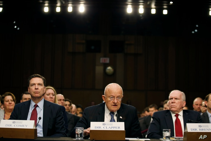 FILE - From left, FBI Director James Comey, Director of the National Intelligence James Clapper, CIA Director John Brennan, participate in the Senate Intelligence Committee's hearing on worldwide threats, Feb. 9, 2016, on Capitol Hill in Washington.