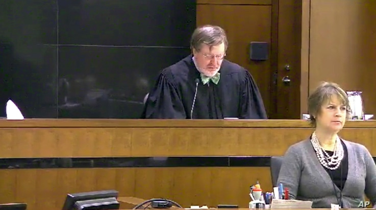 This image taken from United States Courts shows Judge James Robart listening to a case at the Seattle Courthouse, March 12, 2013,  in Seattle, Washington. Robart placed a nationwide hold on President Donald Trump's executive order banning  travel to...