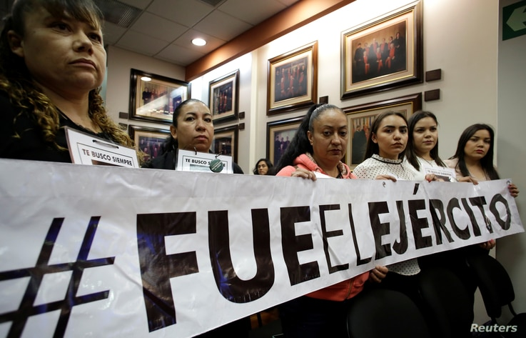 """Relatives of people who went missing in 2009, allegedly as a result of human rights violations by the Mexican military, display a banner that says, """"It was the army,"""" after a hearing convened by the judges of the Inter-American Court of Human Rights ..."""