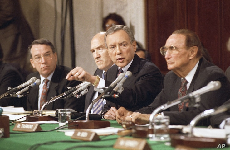FILE - Sen. Orrin Hatch, R-Utah, questions Professor Anita Hill, Oct. 11, 1991, in Washington during a Senate Judiciary Committee hearing on the nomination of Clarence Thomas to the Supreme Court. From left are: Chuck Grassley, R-Iowa, Alan Simpson, ...