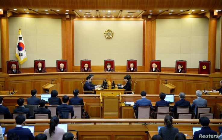 South Korean acting Constitutional Court's Chief Judge Lee Jung-mi (center) and seven judges during final ruling of President Park Geun-hye's impeachment at the Constitutional Court in Seoul, South Korea, March 10, 2017.