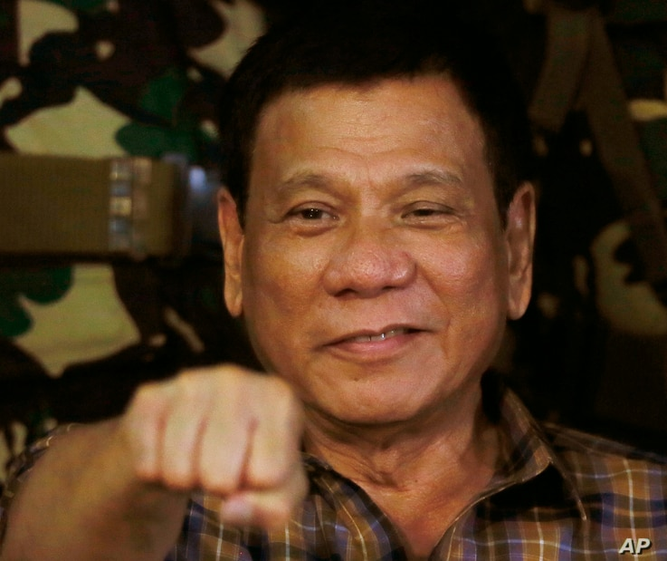 Philippine President Rodrigo Duterte, sen in this Aug. 25, 2016, gestures with a fist bump during his visit to the Philippine Army's Camp Mateo Capinpin at Tanay township, Rizal province east of Manila, Philippines. The Philippine president has apolo...