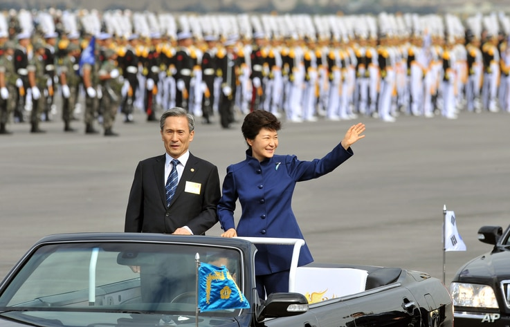 South Korean President Park Geun-hye waves as she inspects troops with Defense Minister Kim Kwan-jin during a ceremony marking the 65th anniversary of the founding of South Korea's Armed Forces, Seongnam, Oct. 1, 2013.
