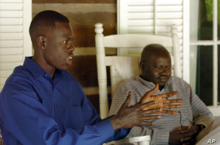 """FILE - Abraham Akoi, left, and Emanuel Solomon discuss their experiences as young children in 1987 fleeing civil war in their home country of Sudan, in Sewanee, Tenn., May 24, 2005. Legislation introduced in the U.S. House seeks to help now-grown """"lo..."""