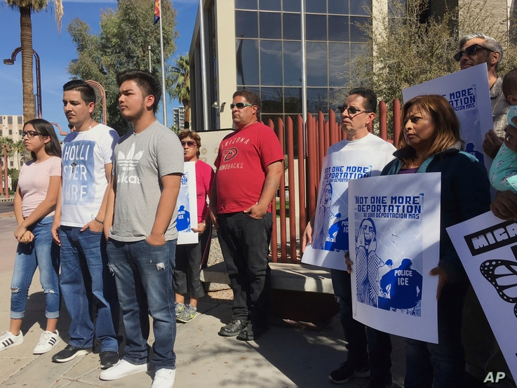 Members of the family of Guadalupe Garcia de Rayos, left, stand with supporters at a news conference in front of the U.S. Immigration and Customs Enforcement office in Phoenix. Garcia de Rayos was deported Feb. 9, 2017.