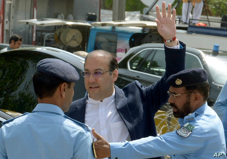 Hassan Nawaz, son of Pakistan's Prime Minister Nawaz Sharif, waves outside the premises of the Joint Investigation Team, in Islamabad, Pakistan, Friday, June 2, 2017, after making his first appearance before the panel probing graft charges against hi...