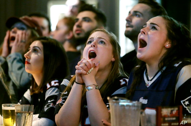 Kathleen Doherty, center, of Woburn, Mass., reacts with other fans at a Boston bar while watching the New England Patriots' final drive during the first half of the NFL Super Bowl 52 football game between the Patriots and the Philadelphia Eagles in M...