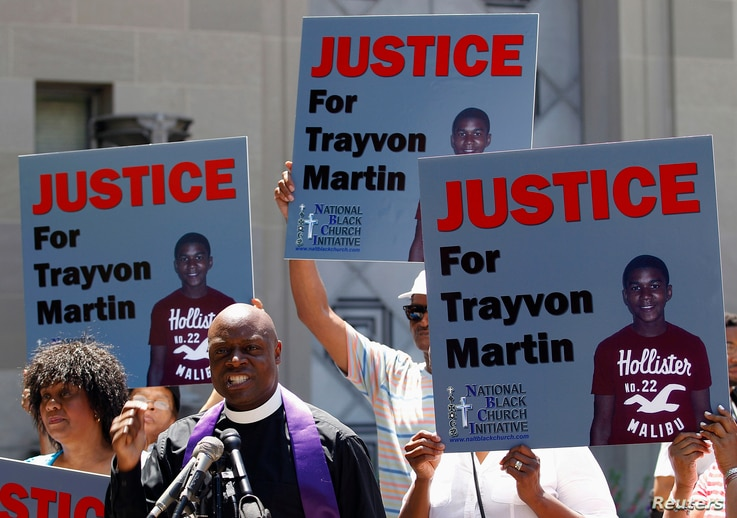 Rev. Anthony Evans, president of the National Black Church Initiative, speaks to the media during a demonstration asking for justice for Trayvon Martin, outside the Department of Justice in Washington, July 15, 2013.