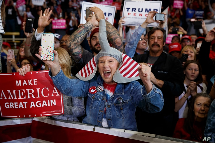 Supporters of Republican presidential candidate, Donald Trump, cheer as he arrives to speak during a campaign rally, in Denver, Colorado, Nov. 5, 2016.