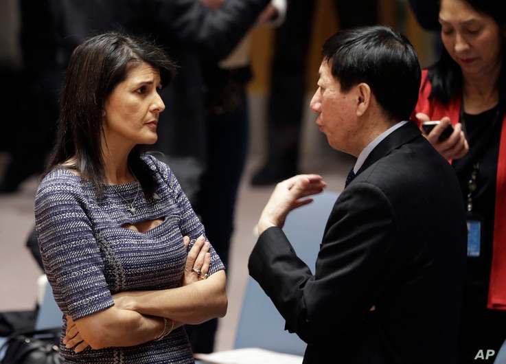 U.S. Ambassador to the United Nations Nikki Haley talks with Chinese deputy ambassador Wu Haitao, Dec. 22, 2017, at United Nations headquarters ahead of a vote on proposed new sanctions against North Korea.