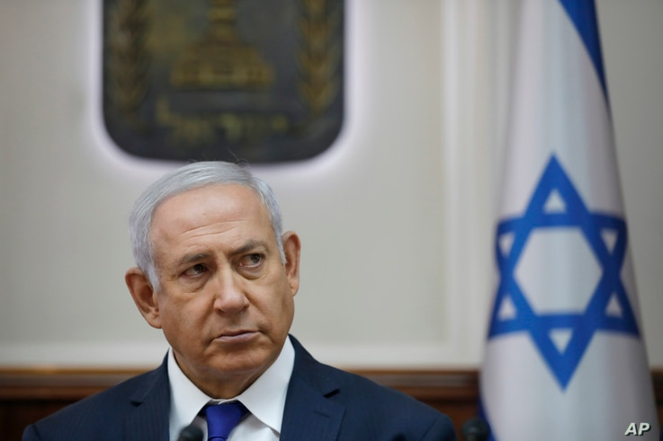 Israel Prime Minister Benjamin Netanyahu attends the weekly cabinet meeting at his office in Jerusalem, Oct. 7, 2018.