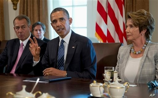 President Barack Obama, flanked by House Speaker John Boehner of Ohio (L) and House Minority Leader Nancy Pelosi of California, speaks to media before a meeting with members of Congress to discuss the situation in Syria, in the Cabinet Room of the W...