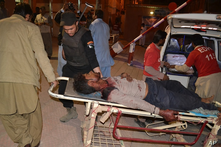Pakistani volunteers rush an injured person to a hospital in Quetta, Pakistan, Oct. 24, 2016.