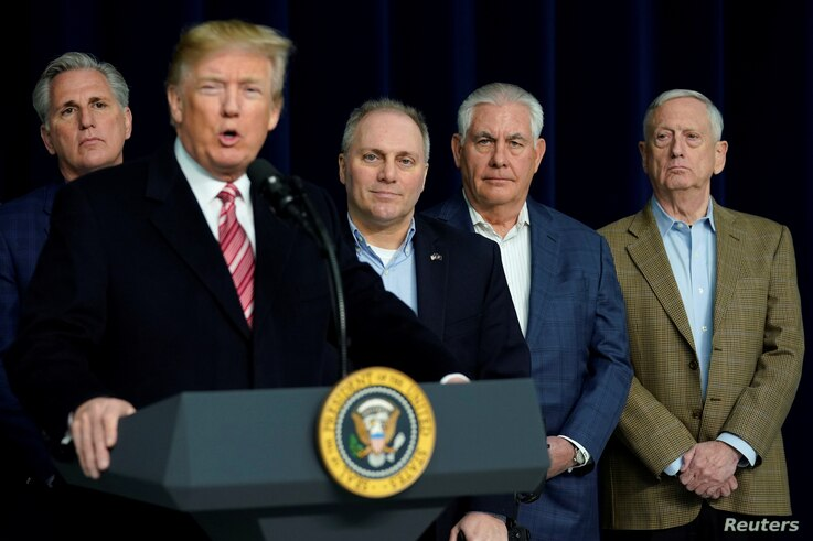 U.S. President Donald Trump speaks to the media after the Congressional Republican Leadership retreat at Camp David, Maryland, Jan. 6, 2018. From left are House Majority Leader Kevin McCarthy (R-CA), Trump, House Majority Whip Steve Scalise (R-LA), ...
