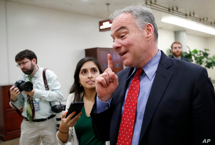 Sen. Tim Kaine, D-Va., talks with a reporter as he arrives for a vote on Gina Haspel to be CIA director, on Capitol Hill, May 17, 2018 in Washington.