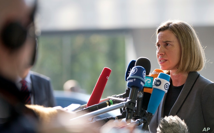 European Union High Representative Federica Mogherini, right, speaks with the media as she arrives for a meeting of EU foreign ministers at the EU Council building in Luxembourg, April 3, 2017.