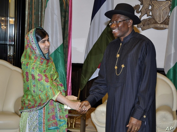 Pakistani activist Malala Yousafzai, left, shakes hands with Nigerian President, Goodluck Jonathan, right, in Abuja, Nigeria, July 14, 2014.