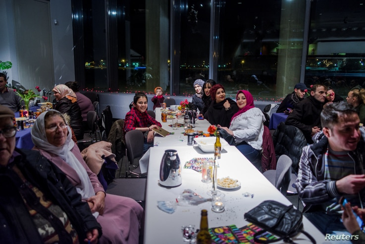 Refugees in Iceland who were invited to attend a New Year's Eve party, are seen at Reykjavik city hall, Iceland, Dec. 31, 2016.
