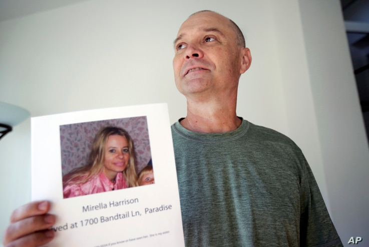 FILE - Bill Engfelt holds the flyer he made while searching for information on his sister, Mirella Harrison, in Solana Beach, Calif., Nov. 27, 2018.