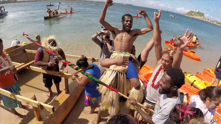 Pacific Climate Warriors celebrate their successful protest, stopping a coal ship from leaving Australia's Port of Newcastle. (Credit: International Wow Company)