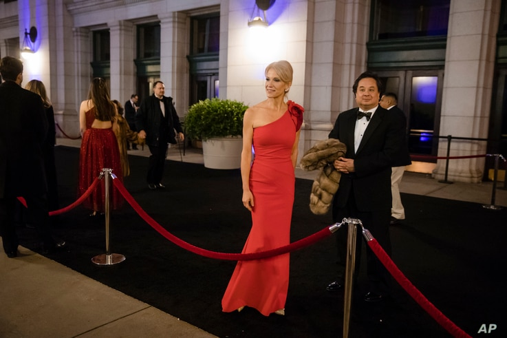 FILE - Adviser Kellyanne Conway, accompanied by her husband, George, arrive for a dinner at Union Station in Washington, Jan. 19, 2017, a day before Donald Trump's inauguration.